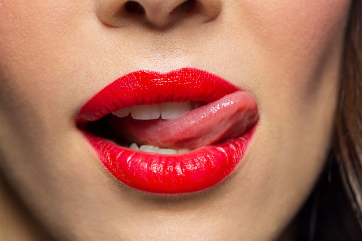 What it means if a girl licks her lips while talking to