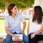 Man and woman sitting talking