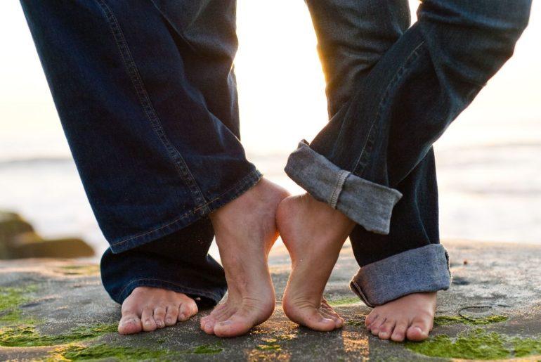 Man and woman touching feet
