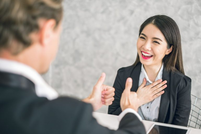 Man complimenting woman who is happy