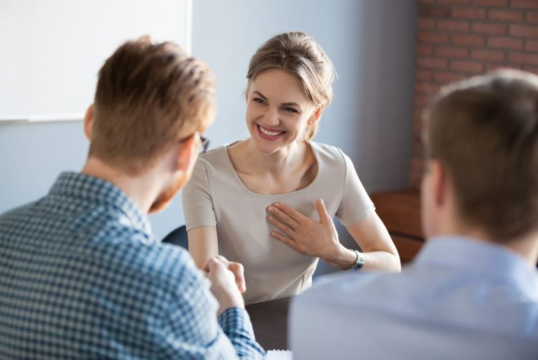 Man giving compliment to woman