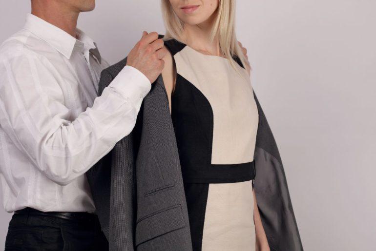 Man giving woman jacket
