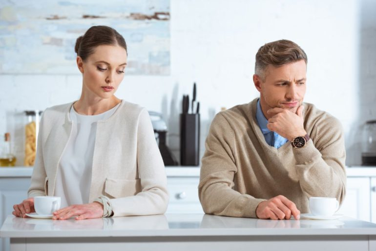 Man looking away from woman