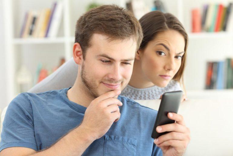 Man on phone woman watching