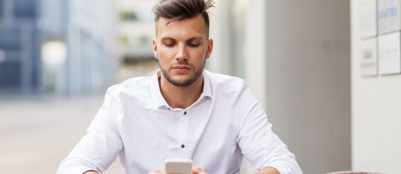 Man sitting texting