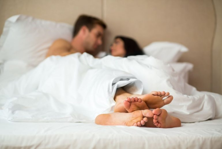 Man sleeping with woman