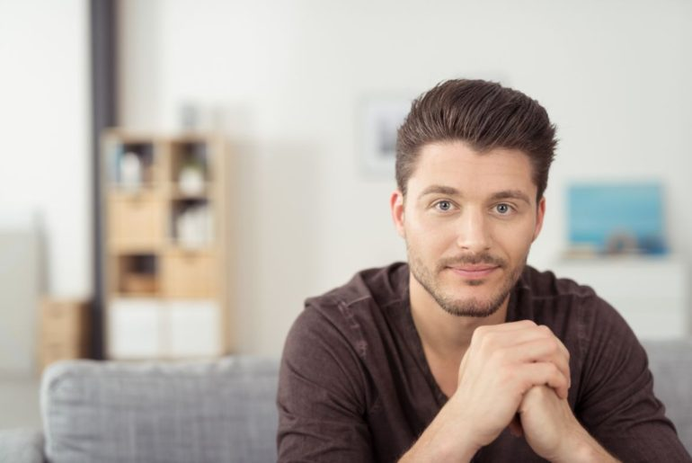 Man staring across room