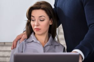 Man touching womans shoulder