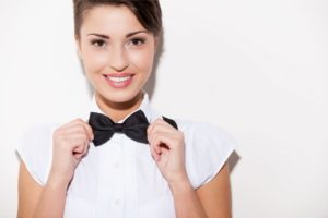 Woman adjusting shirt