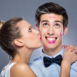 Woman kissing mans cheek