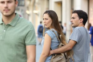 Woman looking at different man