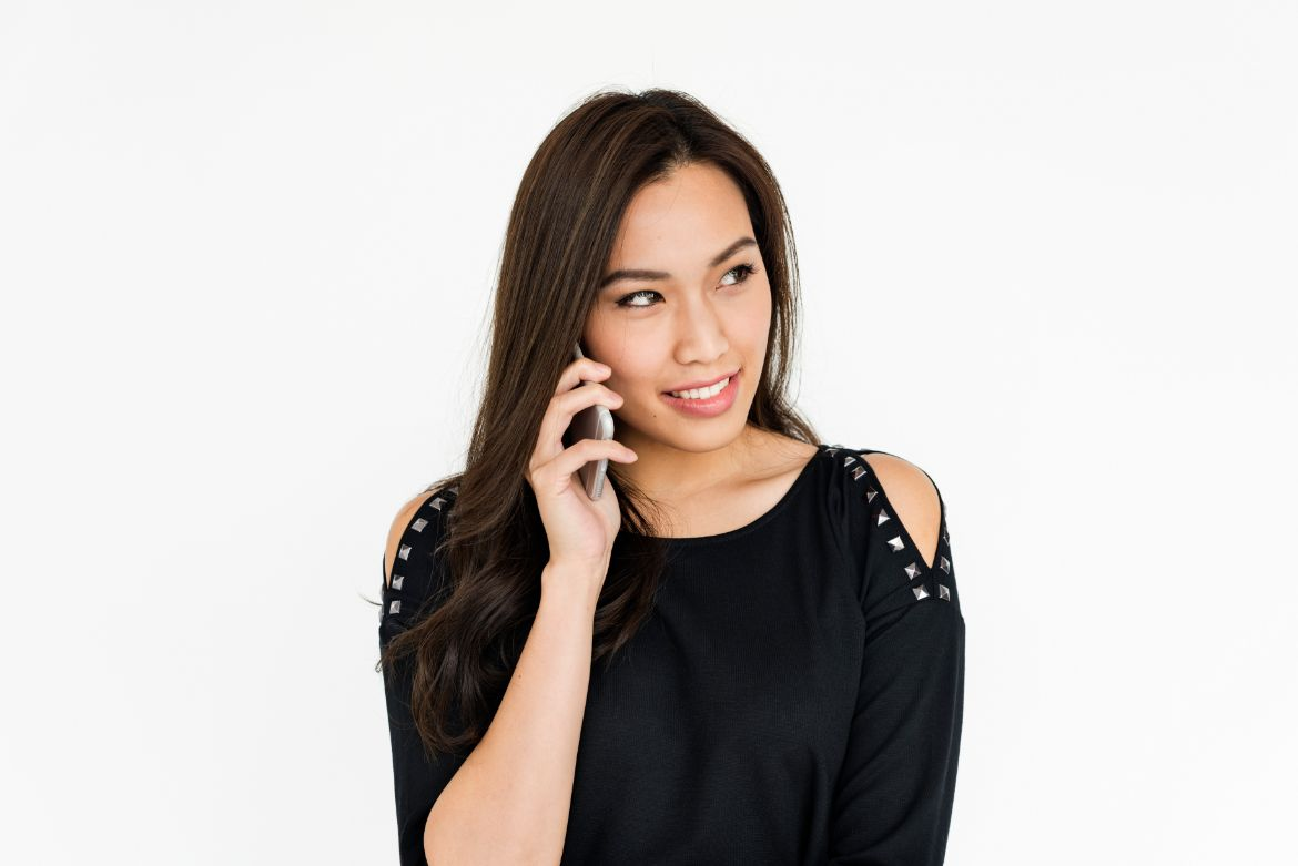 Young asian business woman looking