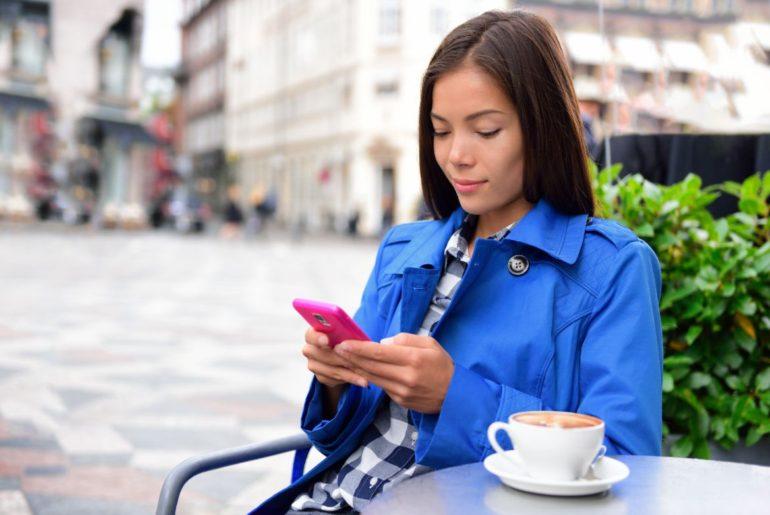 Woman sitting texting