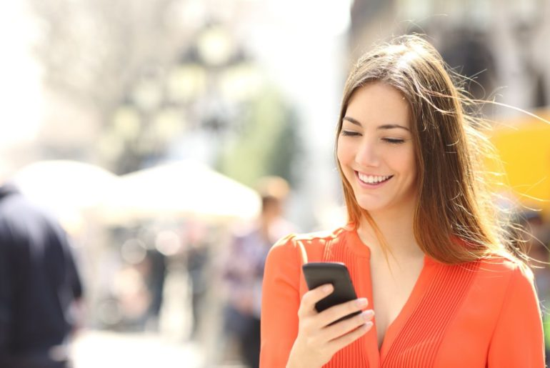 Woman smiling texting