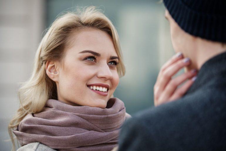 Woman looking at man smiling